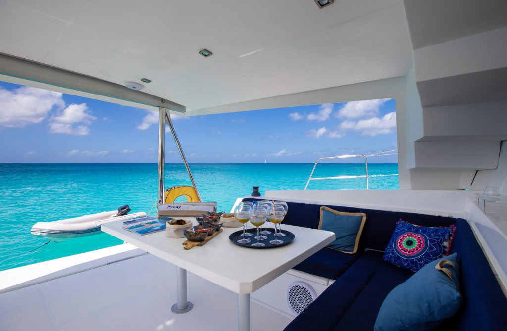 Home appetizers and craft cocktails with a stunning view on the catamaran