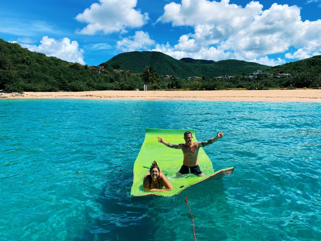 A couple enjoying the privacy in Happy Bay on our floating mat.
